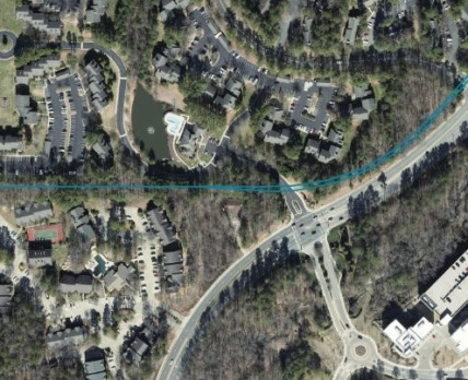 Public transportation or zipline?: On University Drive, the light rail route suddenly cuts between two apartment complexes, and goes through the woods.